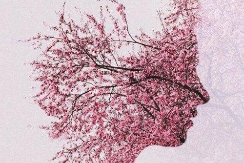 Prosilo di una persona formato da un albero in fiore
