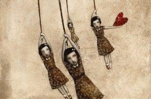 Bambine appesa con cuore età emotiva del disamore