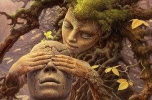 Donna albero che tappa gli occhi a uomo di legno