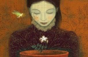 Donna che guarda un fiore previsioni fallite