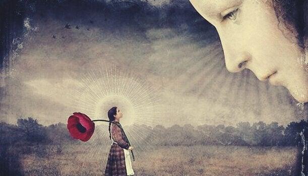 Donna osserva una bambina con un fiore gigante complesso di aristotele