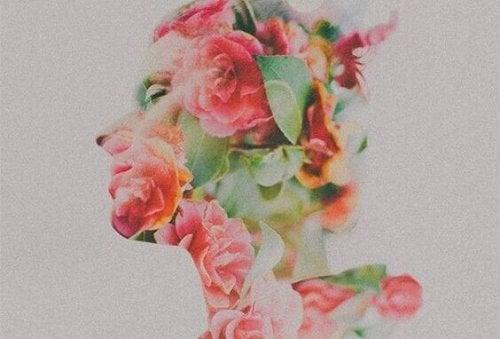Viso di donna con fiori frasi di incoraggiamento