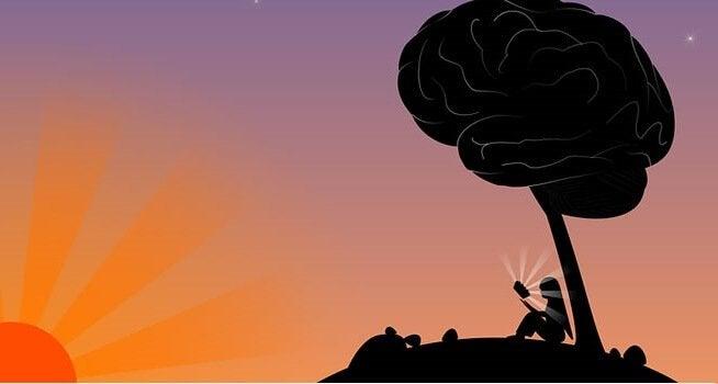 Donna sotto ad albero a forma di cervello