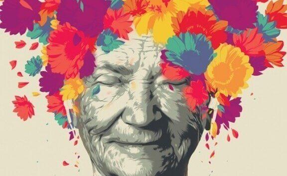 Primo piano di signora anziana con fiori in testa
