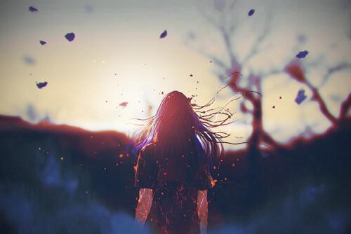 Donna di spalle foglie al vento