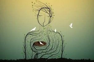 Essere figura femminile a forma di albero e nido nel cuore