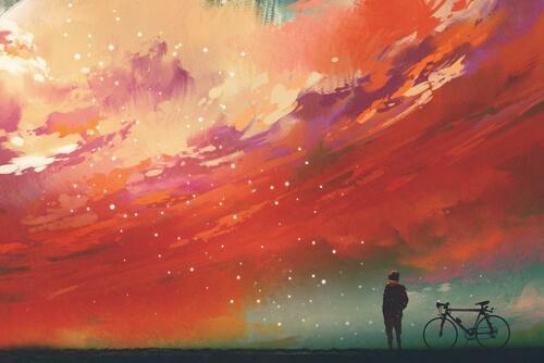 Uomo in bicicletta guarda cielo colorato