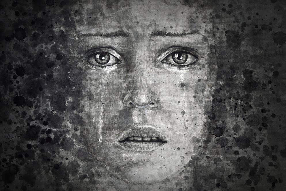 Volto con lacrime in bianco e nero