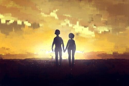 Sagoma di coppia che cammina per mano