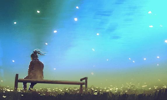 Bambina su una panchina di notte