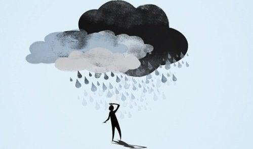 Sagoma con nuvola di pioggia