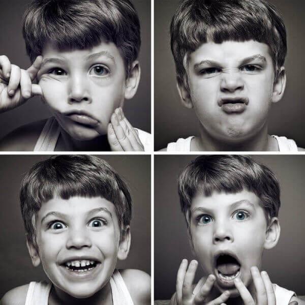 Bambino con diverse espressioni facciali