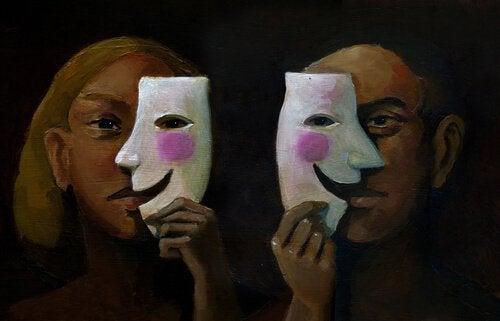 Donna e uomo con maschere