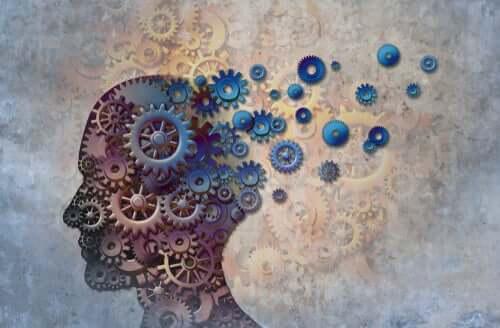 Figura della testa di un uomo formata da meccanismi