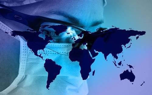 Medico che guarda la mappa del mondo