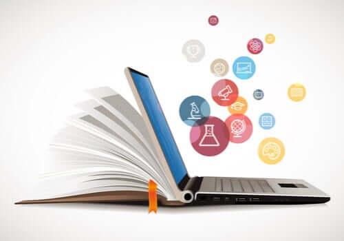 Libro con computer e icone applicazioni