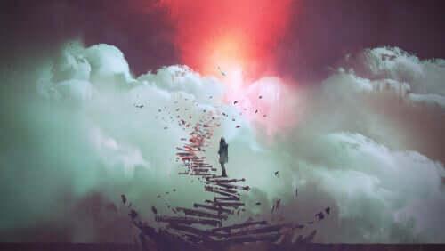 Persona che percorre le scale verso il cielo.