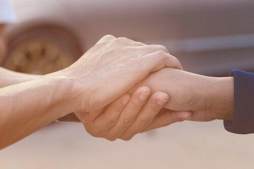 I benefici della empatia e stretta di mano.