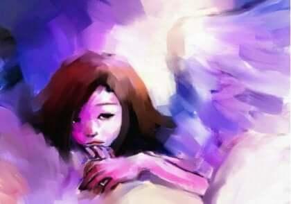 Disegno di bambina con ali da angelo.