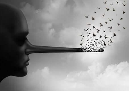 Profilo con naso da pinocchio per rappresentare le bugie.
