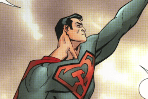 Superman col braccio sinistro alzato.